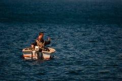 Palamos, Catalonia, may 2016: Fishermen on a small boat Stock Photos