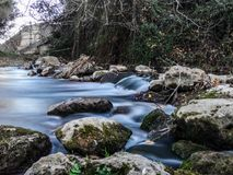 Palancia River waters flowing through the rocks. In long exposure royalty free stock photo
