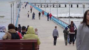 Palanga, Lithuania - July 1, 2018. Palanga Sea Bridge. People walking on a bridge to the sea. Sandy Coast Of The Baltic. Sea stock video