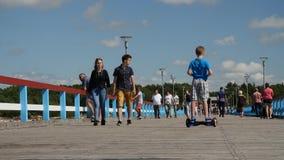 Palanga, Lithuania - July 29, 2017. People walking on a bridge to the sea, time lapse. Palanga, Lithuania - July 29, 2017. People walking on a bridge to the sea stock video footage