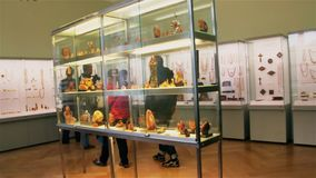 Palanga, Lithuania -July 2018: Tourists examine exhibits at the amber museum in Palanga.  stock footage