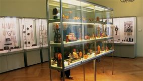 Palanga, Lithuania -July 2018: Tourists examine exhibits at the amber museum in Palanga.  stock video footage