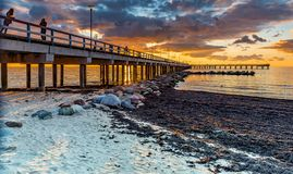 Palanga, Lithuania - October 03, 2013: Marine walking pier in Palanga, Lithuania. The photo was taken at sunset on marine walking pier in Palanga - famous Baltic Royalty Free Stock Image