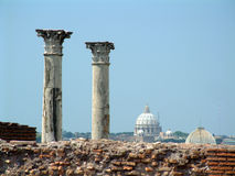 Palantine Pillars and Vatican. Historic Roman Pilars and St Peters Dome, Vatican in background Stock Photo