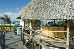 Palapa bar. A palapa bar by the beach at a tropical resort Royalty Free Stock Photo
