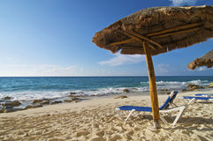 Palapa and Beach Chair. Next to the Caribbean Sea Stock Photos