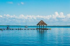 Palapa at the end of the dock royalty free stock photography