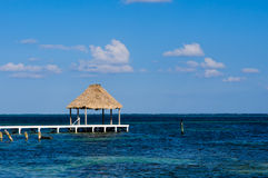 Palapa Hut and Dock on the Ocean. In Belize Royalty Free Stock Photos