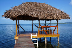 Palapa over the Caribbean sea Stock Images