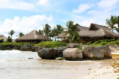Palapa rocks beach and ocean in tropical paradise. At the Caribbean Stock Images