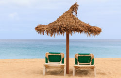 Palapa sun roof beach umbrella in cape verde Stock Images