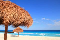 Palapa sun roof beach umbrella in caribbean Stock Images