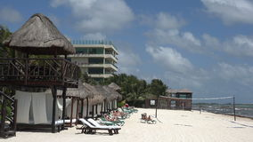 Palapa Sunning on Beach stock footage