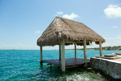 Palapa on the waterer in Lake Bacalar Mexico royalty free stock image