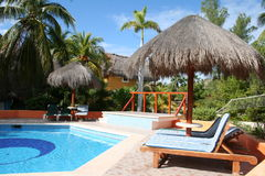 Palapas pool in Tulum - Mexico stock photography