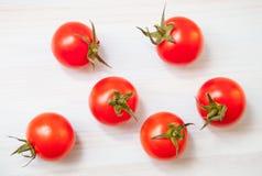 Palatable fresh tomatos. Wooden background stock photo