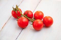 Palatable fresh tomatos. Wooden background stock images