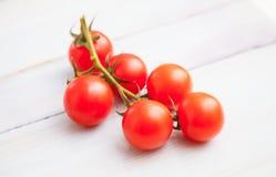 Palatable fresh tomatos. On wooden background royalty free stock photo