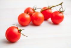 Palatable fresh tomatos. On wooden background stock photos