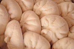 Palatable steamed stuff bun. White palatable steamed stuff bun closeup royalty free stock images