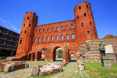 The Palatine Towers ancient roman gate, Turin, Italy. The Palatine Towers, a red brick ancient roman city gate in the Old Town of Turin, Italy royalty free stock photography