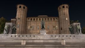 Palatine Towers at the back of Palazzo Madama in the centre of the town centre, photographed at night, Turin Italy royalty free stock photo