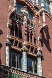 Palau de La Musica Catalana. The side wall of the Palau de La Musica Catalana building with its arches and adornments in downtown Barcelona, Spain royalty free stock images