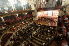 Palau de la Musica Catalana with audience, Spain. BARCELONA, SPAIN - NOVEMBER 26, 2015: Audience and orchestra at the concert Cicle Caral Orfeo Catala in music stock photo
