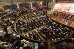 Palau de la Musica Catalana with audience, Spain. BARCELONA, SPAIN - NOVEMBER 26, 2015: Audience and orchestra at the concert Cicle Caral Orfeo Catala in music royalty free stock photos