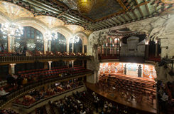 Palau de la Musica Catalana with audience, Spain. BARCELONA, SPAIN - NOVEMBER 26, 2015: Audience and orchestra at the concert Cicle Caral Orfeo Catala in music royalty free stock photography