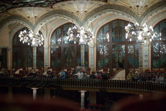 Palau de la Musica Catalana with audience, Spain. BARCELONA, SPAIN - OCTOBER 28, 2015: Audience at the concert classical guitars in music hall Palau de la Musica royalty free stock images