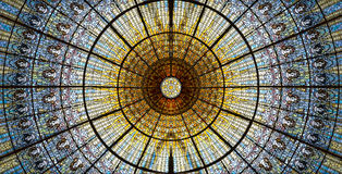 Palau de la Musica Catalana skylight of stained glass designed by Antoni Rigalt i Blanch whose centerpiece is an inverted dome in. Shades of gold, Barcelona stock photos