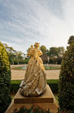 Palau de Pedralbes Statue from behind. Palau de Pedralbes Statue at the entrance. A museum nowadays, was the residence for the Spanish Royal Family when they Royalty Free Stock Photos