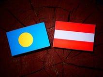 Palau flag with Austrian flag on a tree stump  Royalty Free Stock Photography