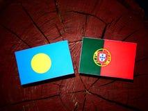 Palau flag with Portuguese flag on a tree stump isolated. Palau flag with Portuguese flag on a tree stump royalty free illustration