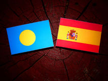 Palau flag with Spanish flag on a tree stump  Royalty Free Stock Photos