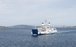 The ferry from palu to maddalena island. Palau,Italy,07-april-2018:The ferry from palau to maddalene island is crossing the opposite ferry, madddalena island is Royalty Free Stock Image