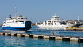 PALAU, SARDINIA/ITALY - MAY 17 : Car ferries leaving and enterin Royalty Free Stock Images