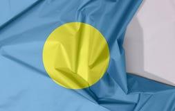 Palau tkaniny flagi zagniecenie z biel przestrzenią i krepa obraz royalty free