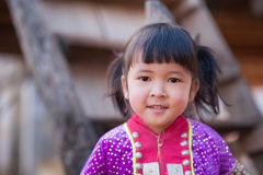 Palaung kid. CHIANGMAI,THAILAND - JANUARY 11, 2015: Unidentified Palaung kid in the Palaung traditional costume poses for the camera. Palaung people is a Royalty Free Stock Photo