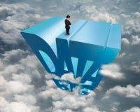 Palavra azul grande dos dados 3D com o homem de negócios que está na parte superior Fotos de Stock