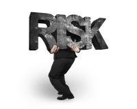 Palavra concreta levando do risco do homem isolada no branco Fotografia de Stock Royalty Free
