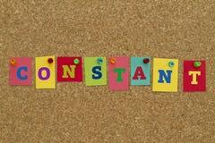 Palavra constante escrita em notas pegajosas coloridas Fotos de Stock Royalty Free