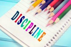 Palavra da disciplina no caderno foto de stock