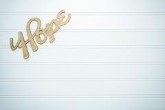 Palavra da esperança na placa de madeira branca Imagem de Stock