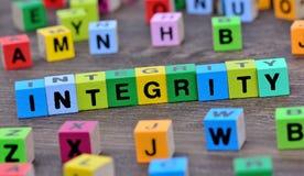 Palavra da integridade na tabela Fotografia de Stock Royalty Free