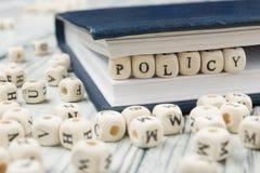 Palavra da política escrita no bloco de madeira ABC de madeira fotografia de stock royalty free