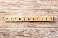 Palavra da probabilidade escrita no bloco de madeira texto na tabela, conceito da probabilidade fotos de stock royalty free