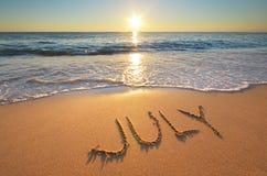 Palavra de julho no mar Imagens de Stock