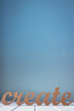 A palavra de madeira cria contra um fundo azul Foto de Stock Royalty Free